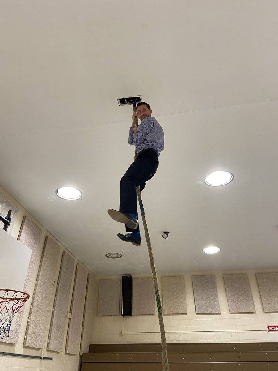 Mr. Prezioso climbing the rope during PhysEd Class - Jan. 2020