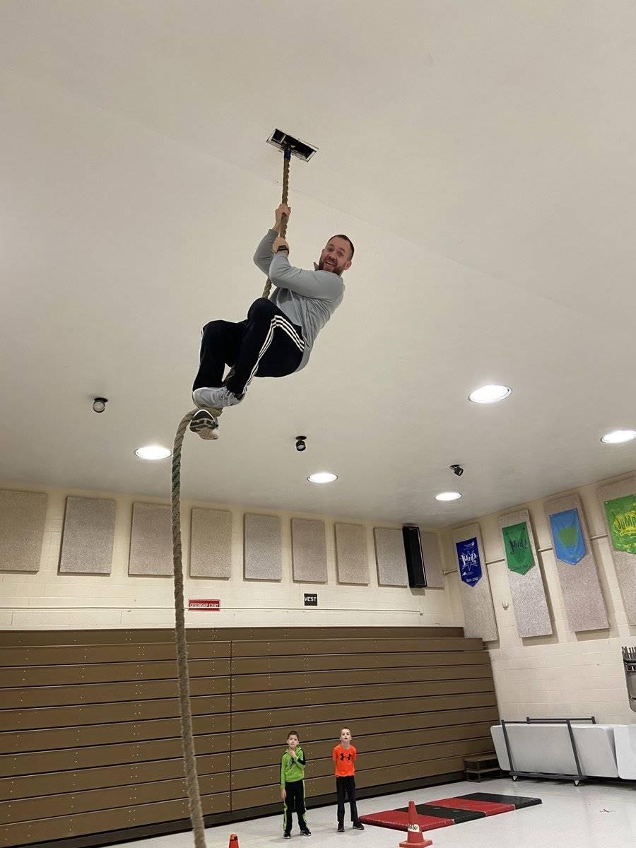 Mr. Hazen climbing the rope during PhysEd Class - Jan. 2020